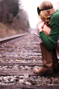 sitting on train tracks